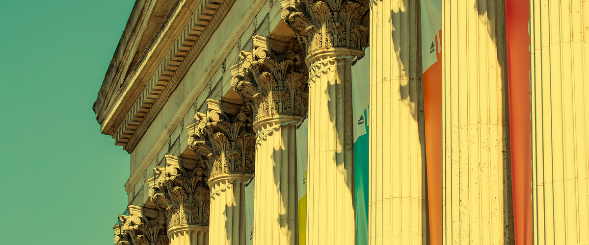 portico with coloured banners
