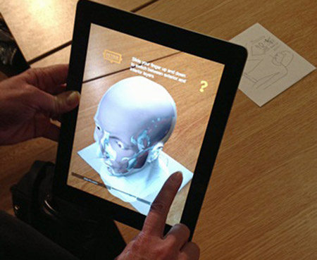 App showing facial reconstruction over skull UC31176