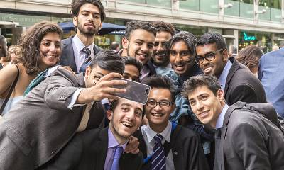 Students taking a selfie at their graduation