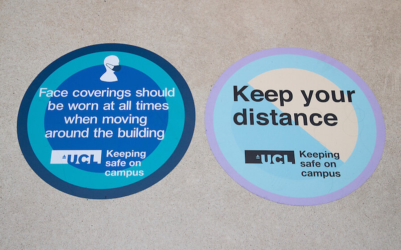 Keep your Distance and Cover your face signs on the floor on UCL campus