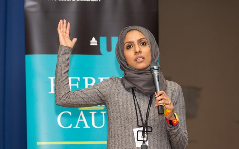 Alumna delivering a presentation