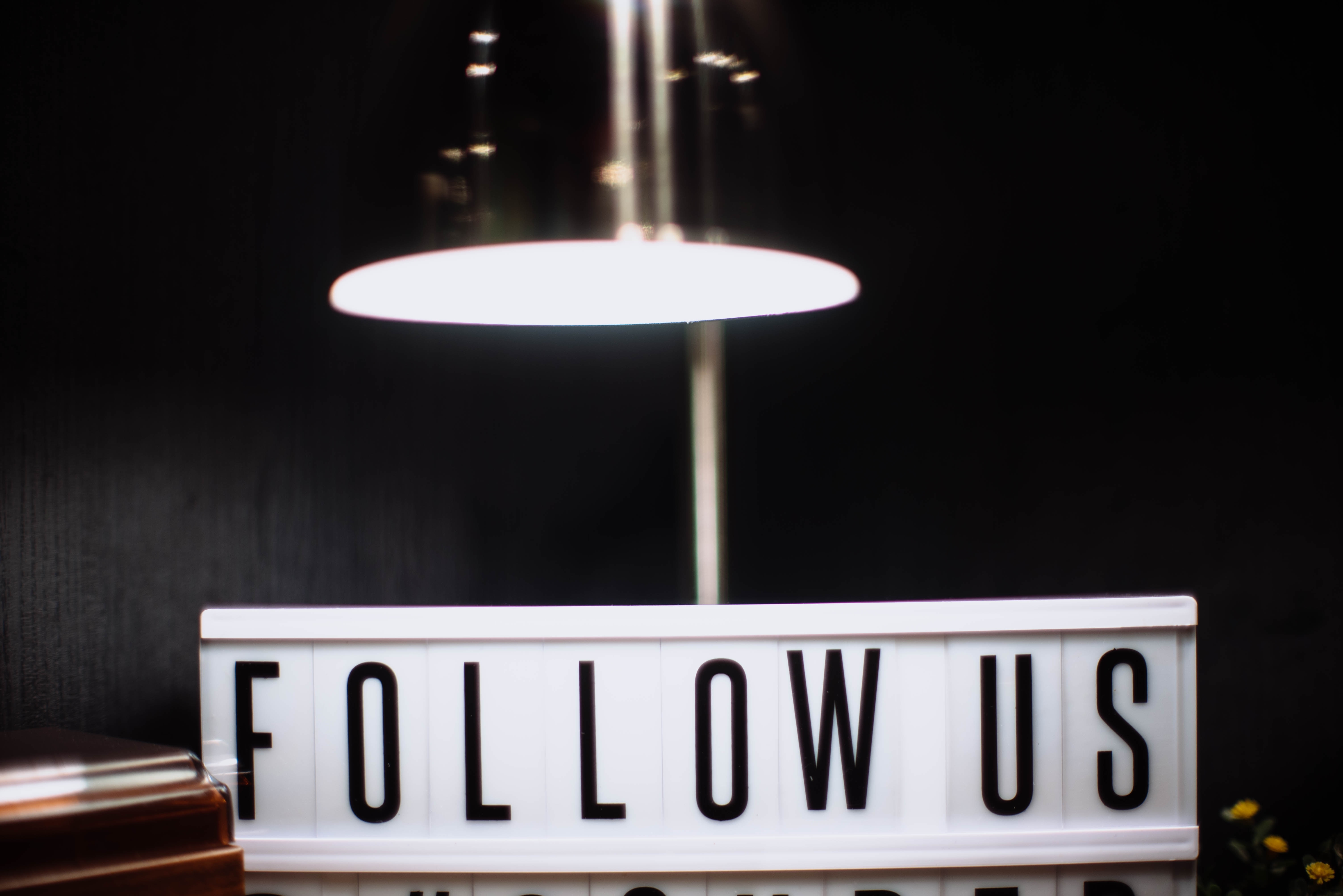 Follow us sign
