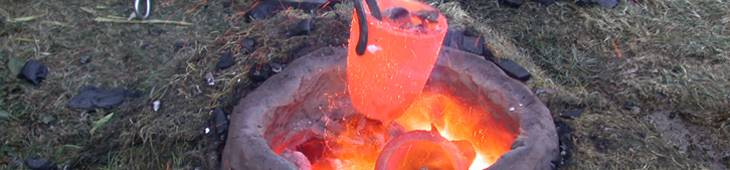 Crucible being removed from bowl furnace in experimental reconstruction