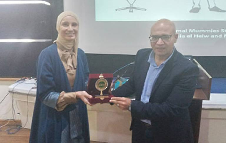 Heba Abd El Gawad being presented award by the Vice Dean for Community Services and Environment Development , Prof. Ibrahim Badr,  Must University, Cairo