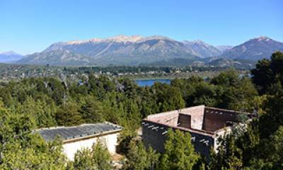 View across the remains of the former experimental reactor Number 1 and towards the city of San Carlos de Bariloche on Isla Huemul, Argentina