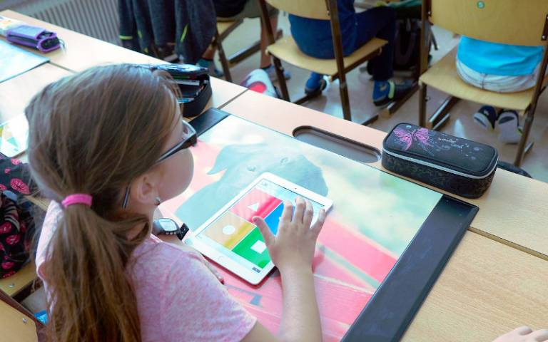 Girl using tablet in classroom