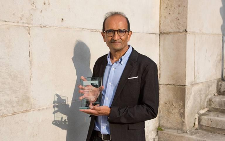 Prof Raman Prinja with award