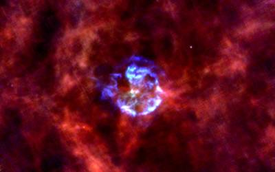 Herschel image of the Galactic Supernova Remnant Cassiopeia A. Blue is supernova dust emission at a wavelength of 70 microns and red is interstellar dust emission at a wavelength of 160 microns