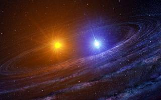 This artist rendering depicts the RS Ophiuchi binary system shortly after the white dwarf (right) has exploded as a nova. The other star is a red giant. Note the spiral dust lanes. Credit: Casey Reed/NASA