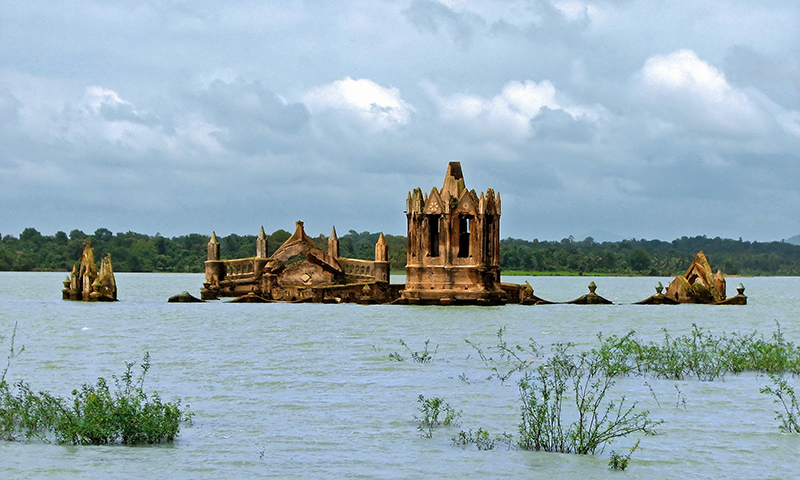 Old ruins emerge from the surface of a lake
