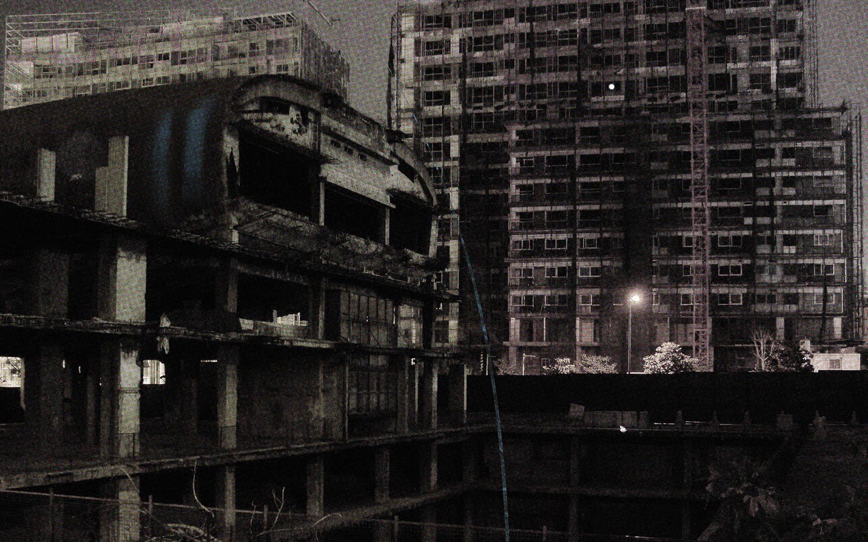 Black and white photo of demolished flats