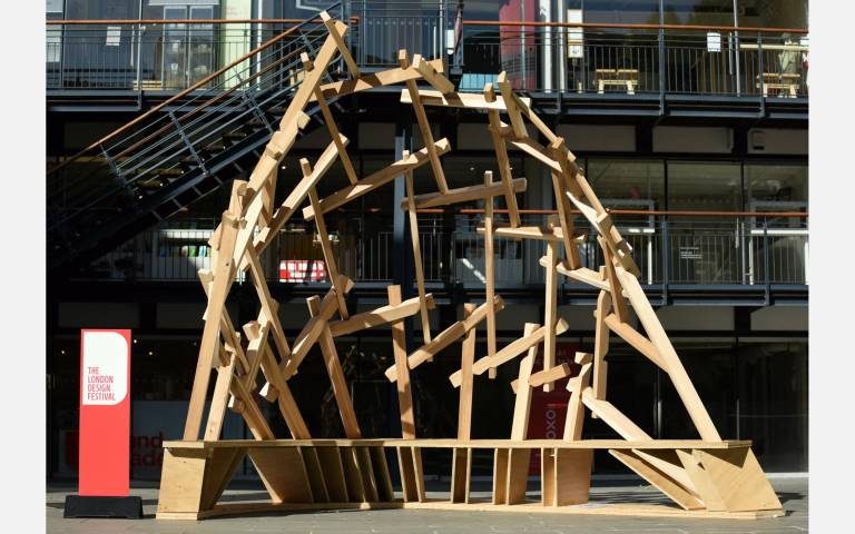 Wooden structure in front of Oxo Wharf Tower