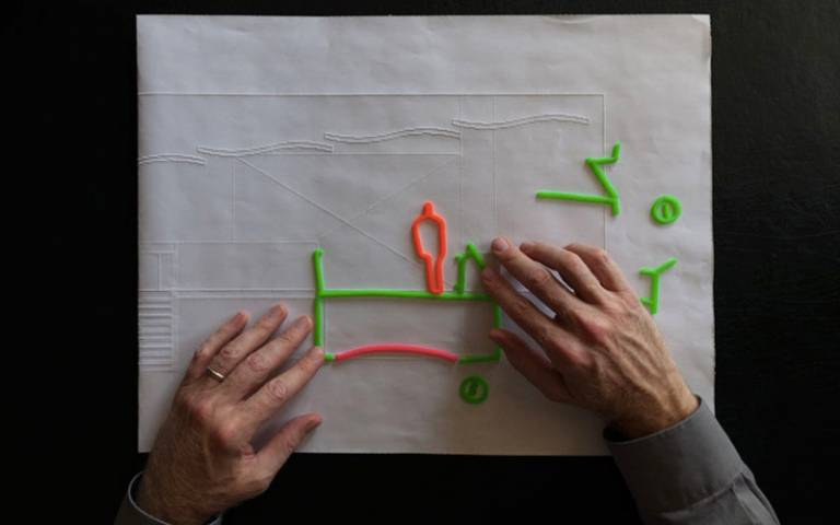 Chris Downey working on a project for the Blind Rehabilitation Center. Wax stick sketch on embossed section drawing of Lobby Bridge. Photography by Don Fogg.