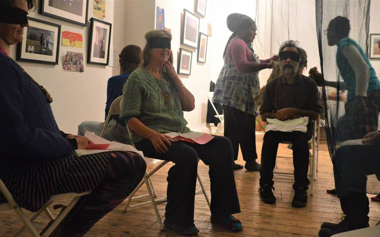 blindfolded participants sat on chairs smelling foods