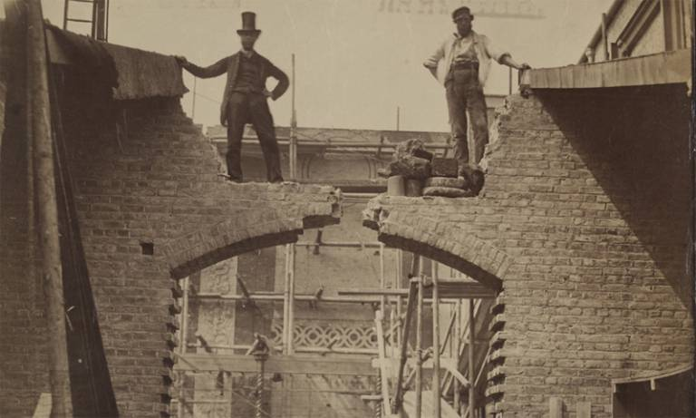19th-century photograph of two men standing on a building site