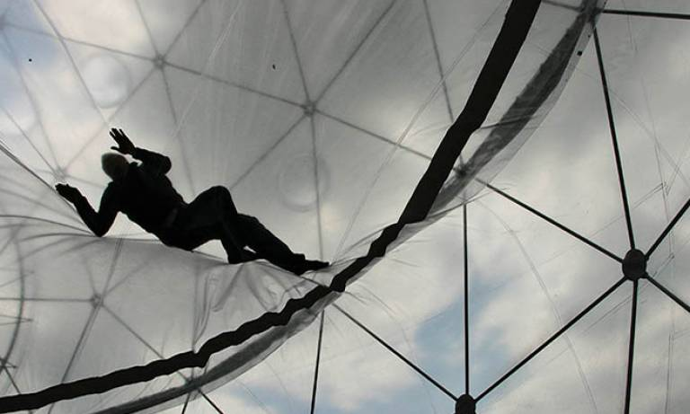 A man climbing on a glass roof