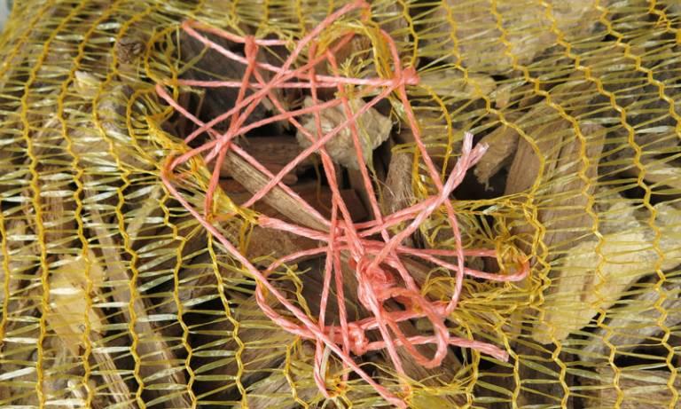 Chunks of wood in plastic netting