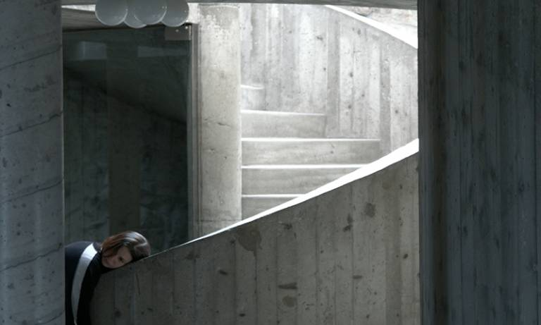 Woman leaning on a concrete staircase