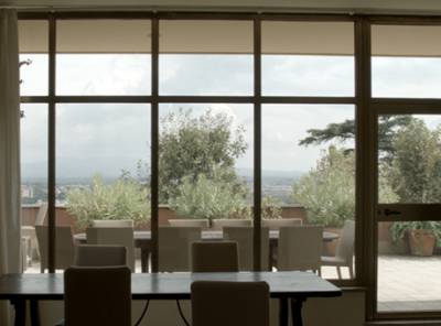 View out of a window onto a terrace and distant landsapce