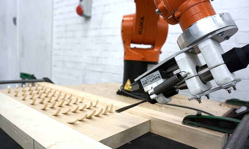 Robotic arm used to chisel wood