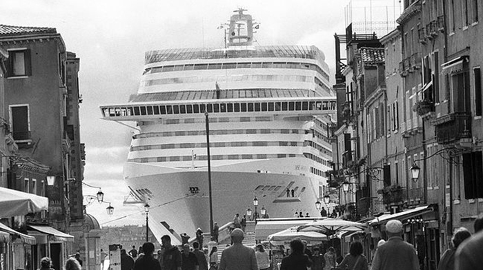 Giant cruise ship seen from the streets of Venice