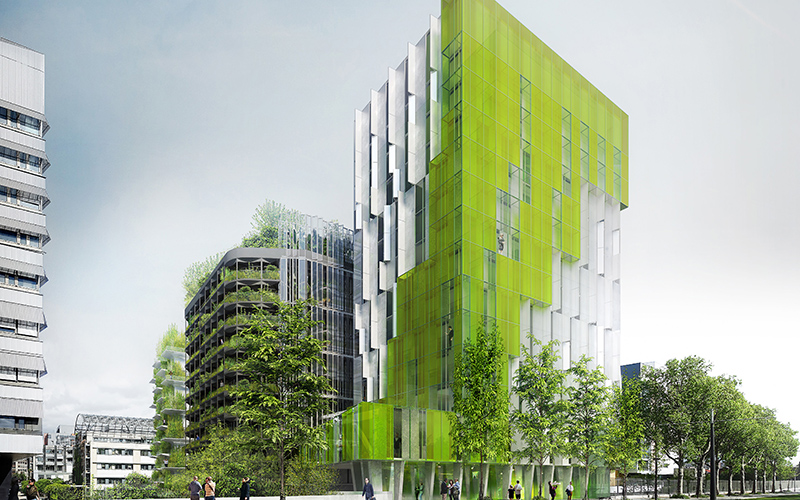 Tall blocks of flats and office with green colouring and lots of plants
