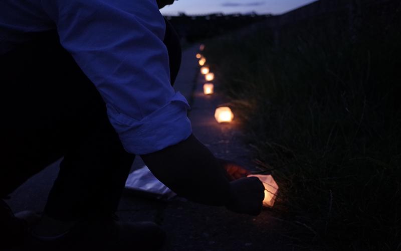 Person lighting a lantern