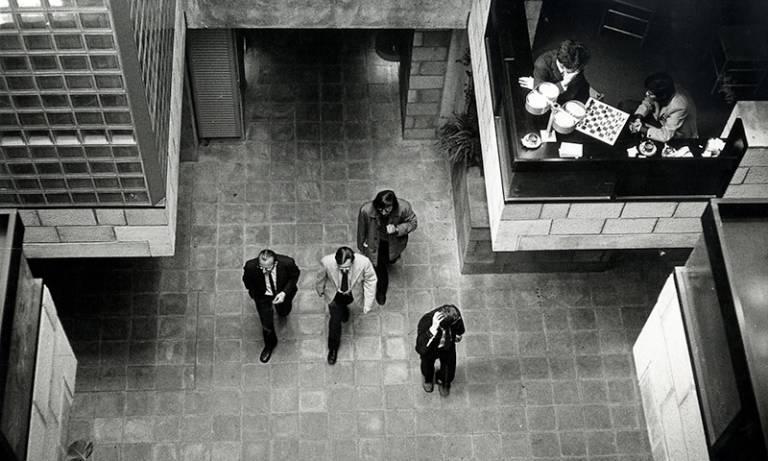 Aerial view of men walking through a building