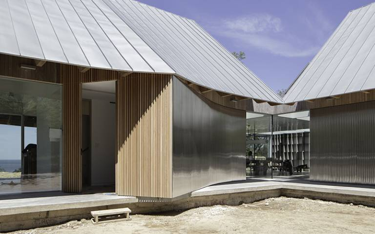 Wooden, metal and glass house structure on a beach