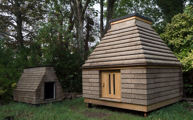 The Cork Cabin prototype building around 6 months after construction, standing next to the Cork Casket ©Matthew Barnett Howland and Oliver Wilton