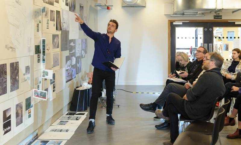 A student presenting his work during the Open Crits 2017