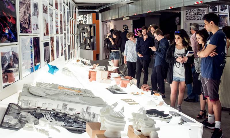 Students and visitors looking at work during the Summer Show 2015 opening