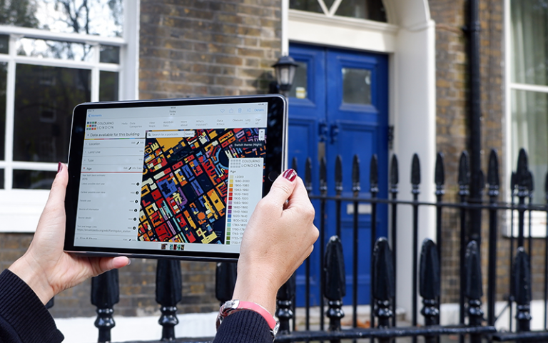 The Colouring London website viewed on an iPad on a London street.