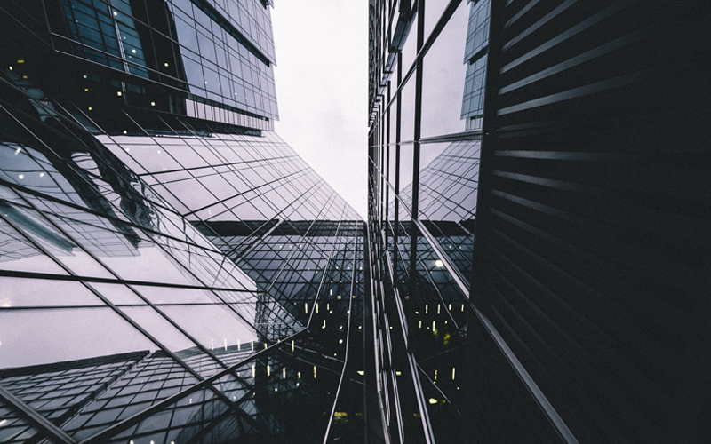 Low angle photo of corporate buildings