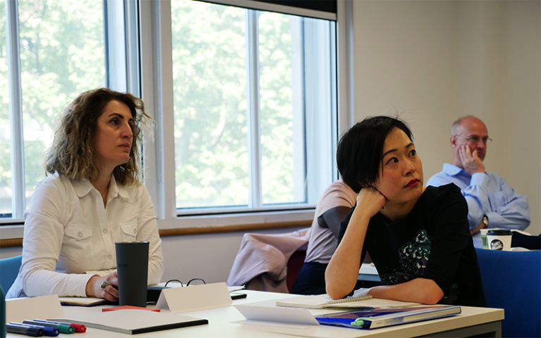 School staff and PhD students attend a BSCPM research seminar