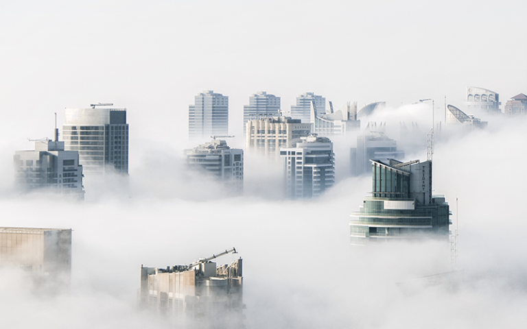 Castles in the air - aerial image of buildings covered in clouds