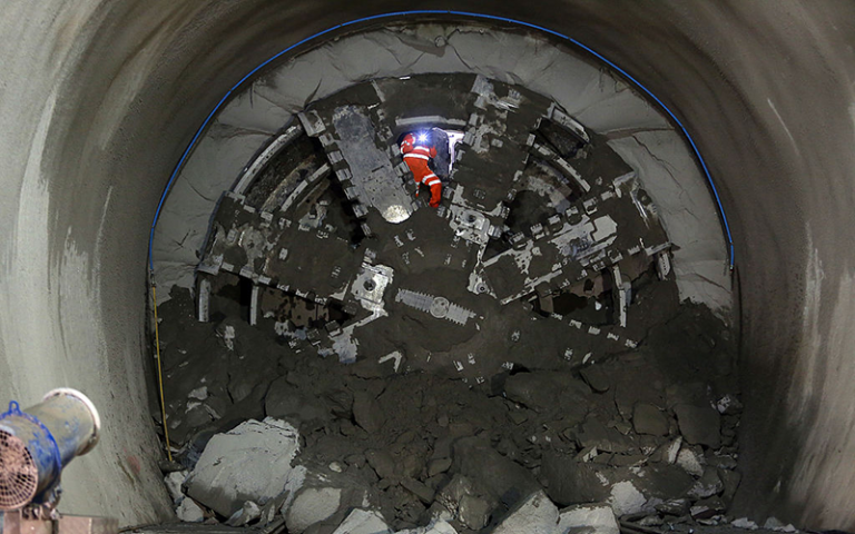 Construction worker takes a photo during the Crossrail project