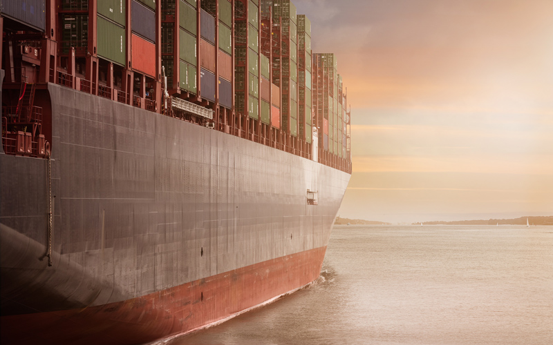 Container ship at sea in the evening light