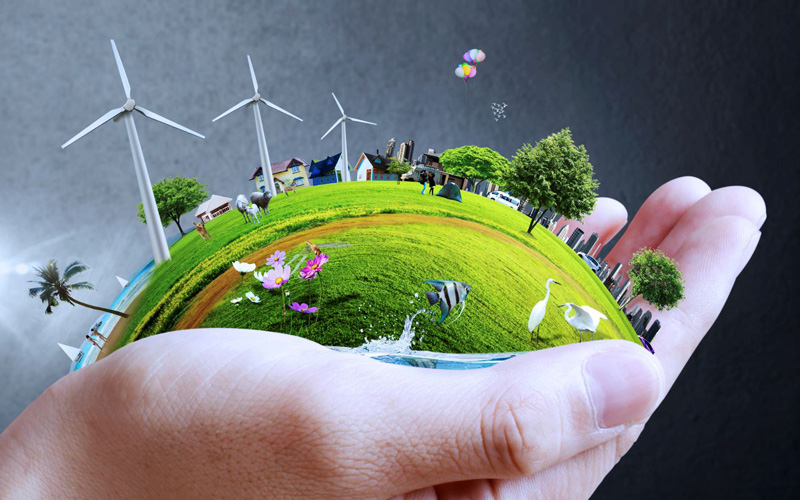 Graphic illustration for the ERBE Centre for Doctoral Training: a hand holds a miniature green world with wind turbines