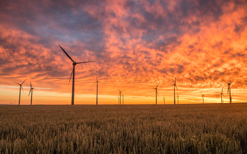 Wind turbines at sunset - Photo by Karsten Würth (@inf1783) on Unsplash