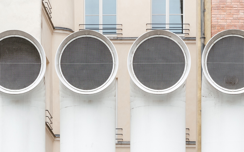 White building ventilation funnels - Photo by Samuel Zeller on Unsplash