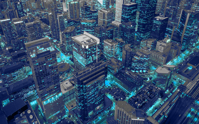 Aerial view of skyscrapers in city with blue lights
