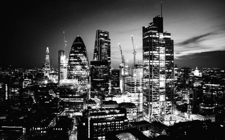 Black and white image of City of London skyline at night - Photo by Dil on Unsplash