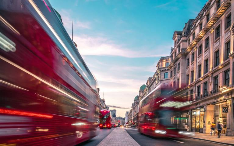 Buses on Oxford Street. Photo by Lachlan Gowen on Unsplash