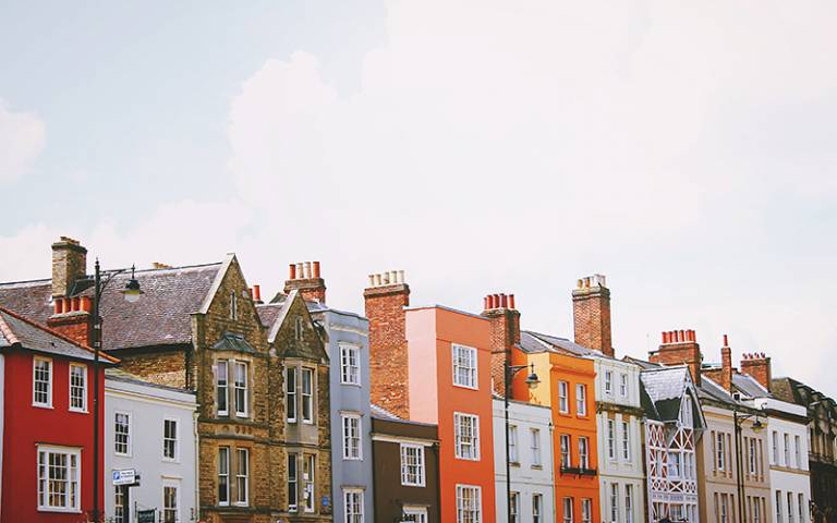 Photo shows a row of terraced houses