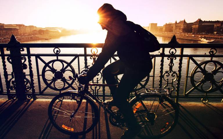 Man cycling over bridge in Budapest, Hungary - Photo by Viktor Kern on Unsplash