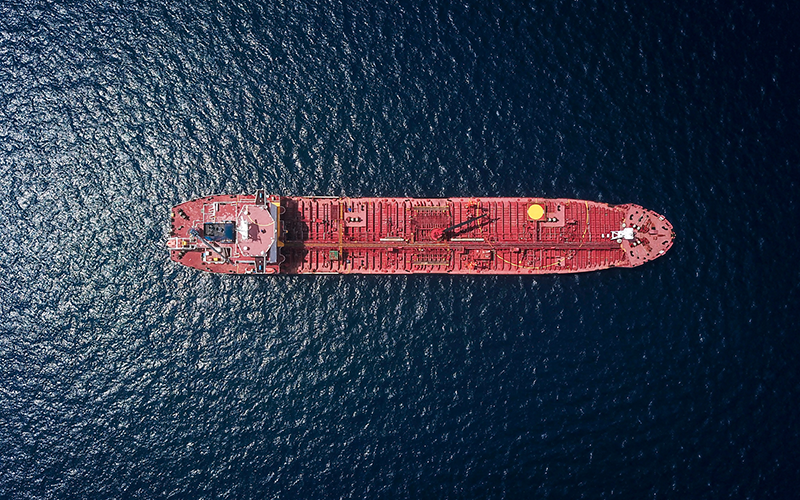 Aerial photograph of red tanker ship in the sea