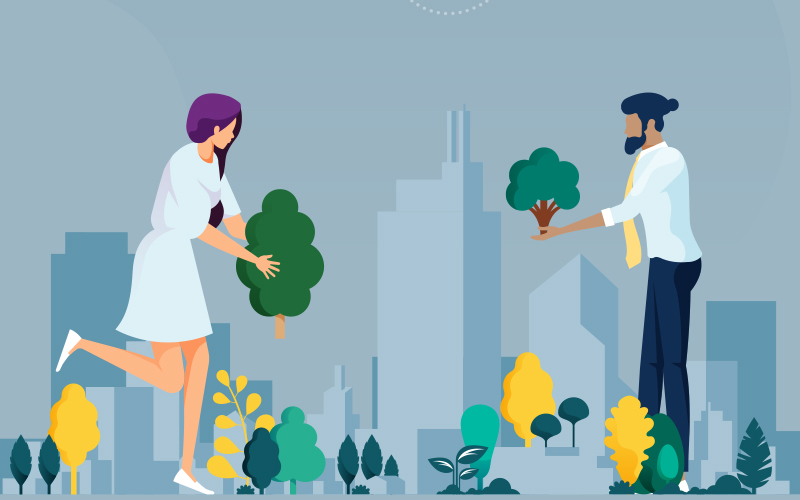 A man and a woman in suits planting trees, or 'greening' a city scape