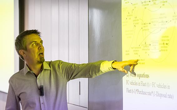 A man talking through an energy model