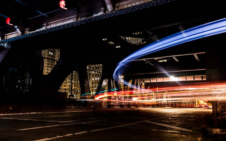 View of city street at night with car lights - Photo by Alejandro Benėt on Unsplash
